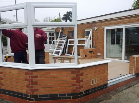 Building the brick conservatory base and installing the first uPVC window frames