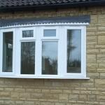 a white upvc bow window