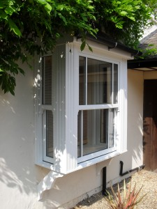 a white upvc bay window- sash windows are secure