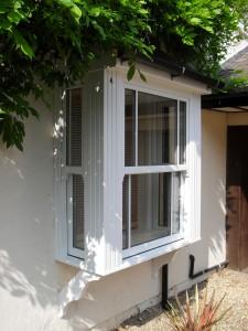 a white upvc bay window- sash windows are secure
