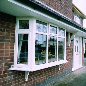 white upvc bay window on property front